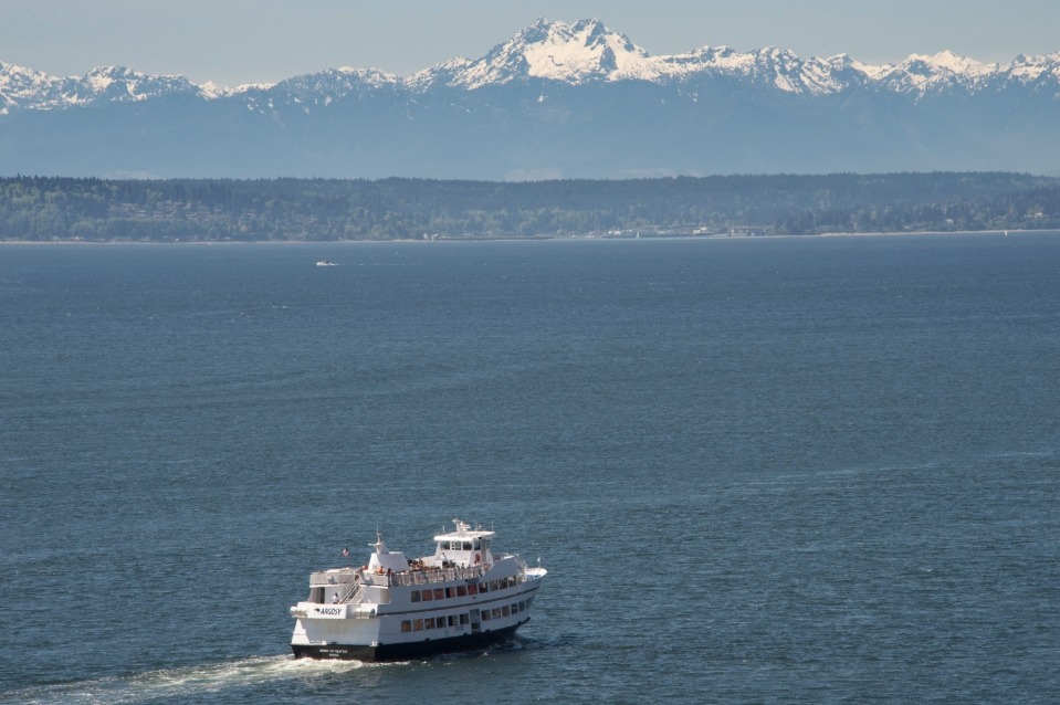 Seattle ferries with Olympic Mts in background, Washington